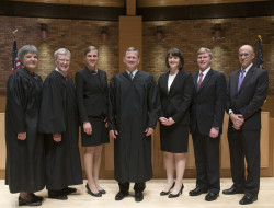 From left: Judge Brown, Judge O'Scannlain, Maggie Hall, Chief Justice Roberts, Meredith Price, Andy Erickson, and Dean Klonoff