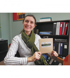 SBLC Executive Director Julieanna Elegant holding a client's product, NW Ferment's fermentati...