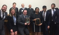The Jessup International Moot Court team celebrates after a successful run at Regionals.