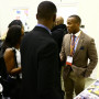 SBA President Lawrence Pittman '18, talks to potential students at a recruiting event
