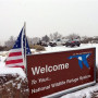 An sign of the National Wildlife Refuge System is seen at an entry of the wildlife refuge about 3...