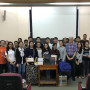 Professor Klonoff with 240 pounds of donated law casebooks, and his Cambodian students.