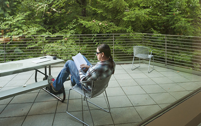 Student studying outside on the Boley patio. There are lots of great study spots on our campus, b...