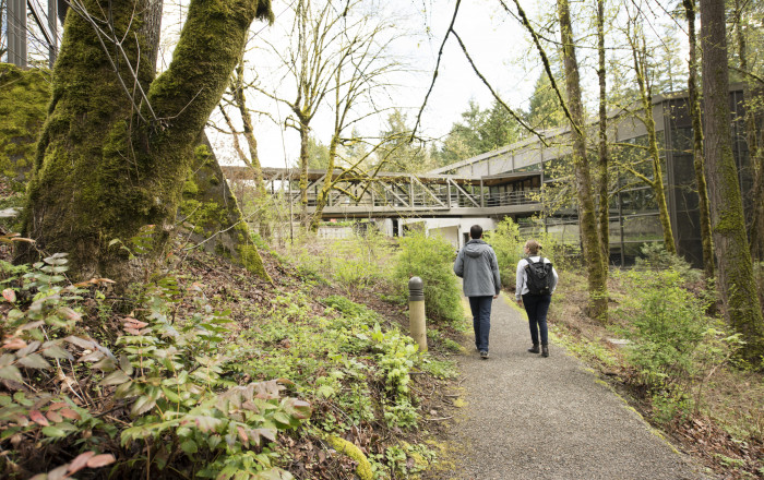 Students on the connecting pathway. Many people use the forested pathway behind our campus as a s...