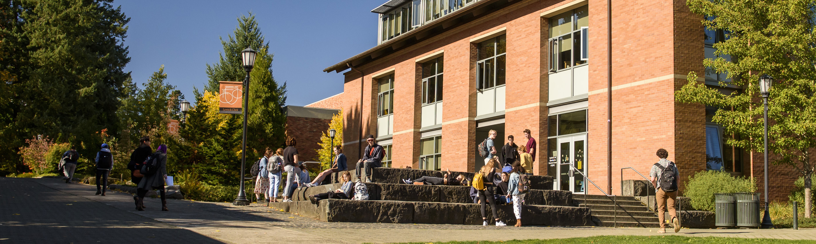 Students talking outside J.R. Howard Hall
