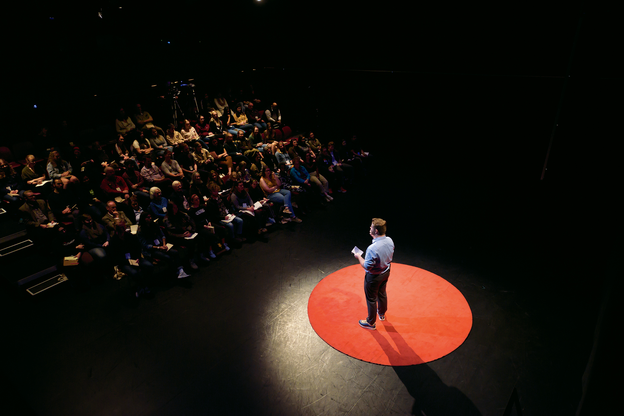 TEDx speaker Tom Stratton BA '20 in the Black Box Theatre.
