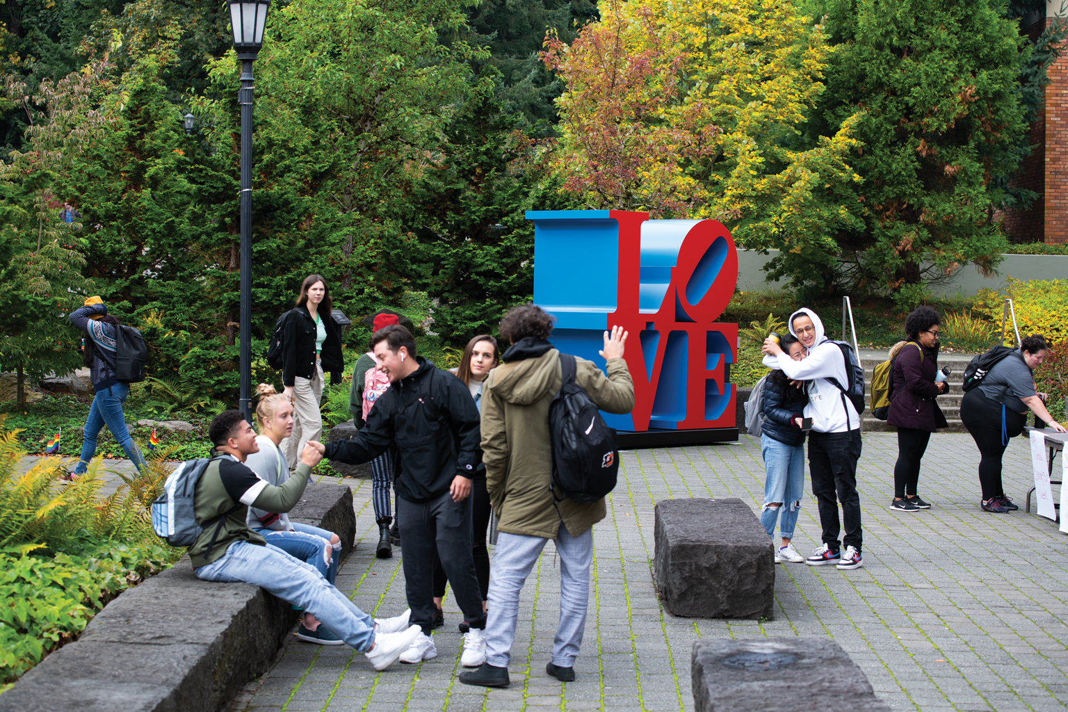 Students mingle outside J.R. Howard Hall, where Robert Indiana's iconic LOVE sculpture is on di...