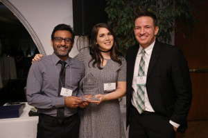 Lewis & Clark Law School's Raj Reddy (left) and Priscilla Rader (center) accept the awar...