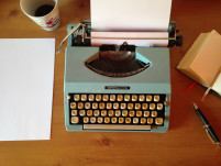 Typewriter and coffee cup