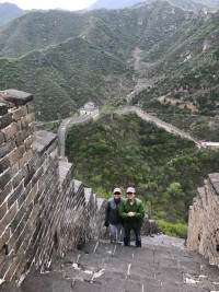 Hong Ai '97 and Dean Jennifer Johnson make the steep climb up the Great Wall.