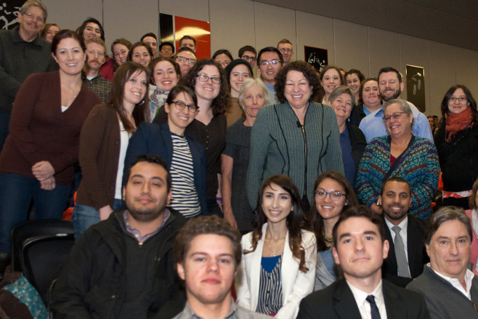 U.S. Supreme Court Justice Sonia Sotomayor pauses for a photo amid members of the audience.