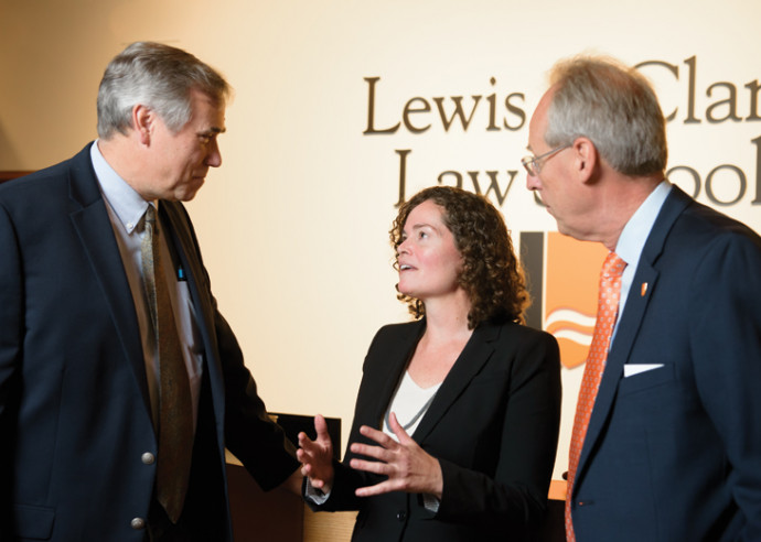 U.S. Senator Jeff Merkley and Lewis & Clark President Wim Wiewel talking with Professor Melis...