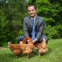 Matt spending time with three spent hens rescued from an egg factory farm in North Carolina.