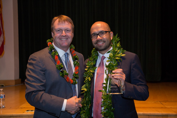 Elliot Mainzer of the Bonneville Power Administration congratulates Marcus Chong Tim JD '06, wi...