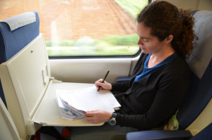 Professor Powers: grading papers on train in Spain