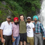 Victor Reuther (middle) with new friends at Bhagsu Falls, India